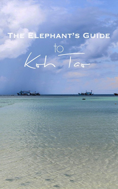 Turquois and blue ocean with a few stormy clouds and thai boats with text overlay - The Elephant's Guide to Koh Tao
