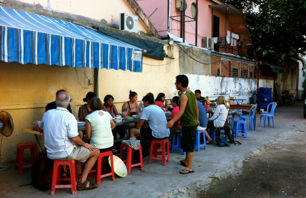 vietnamese street restaurant and group eating