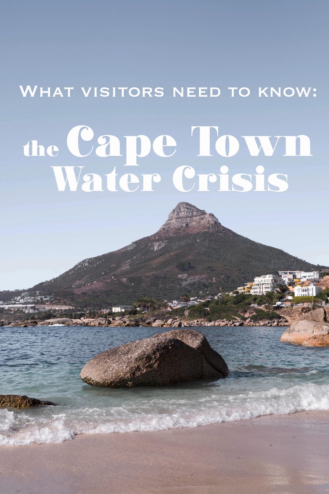 View of a beach with bolders and Lion's Head text overlay - the cape town water crisis