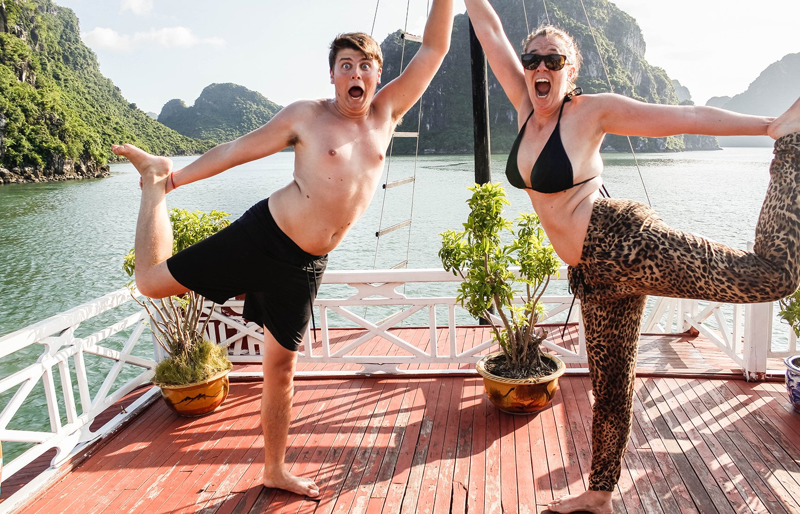 Halong Bay Cruise with people doing yoga
