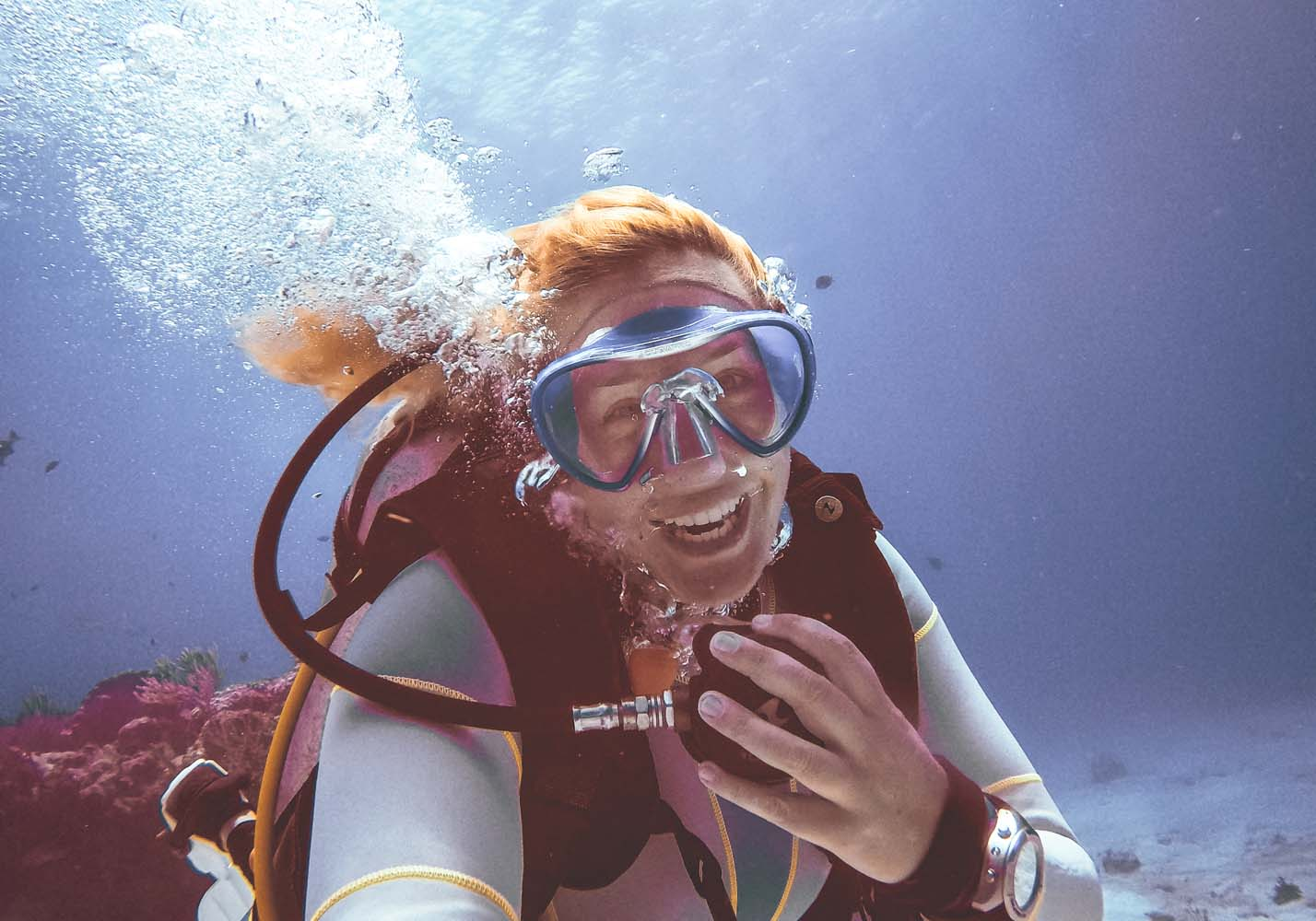 Woman scuba diving smiling underwater in Mexico