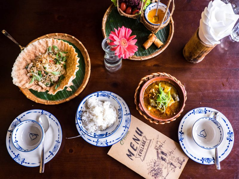 various vietnamese food on a table at e village restaurant in hoi an