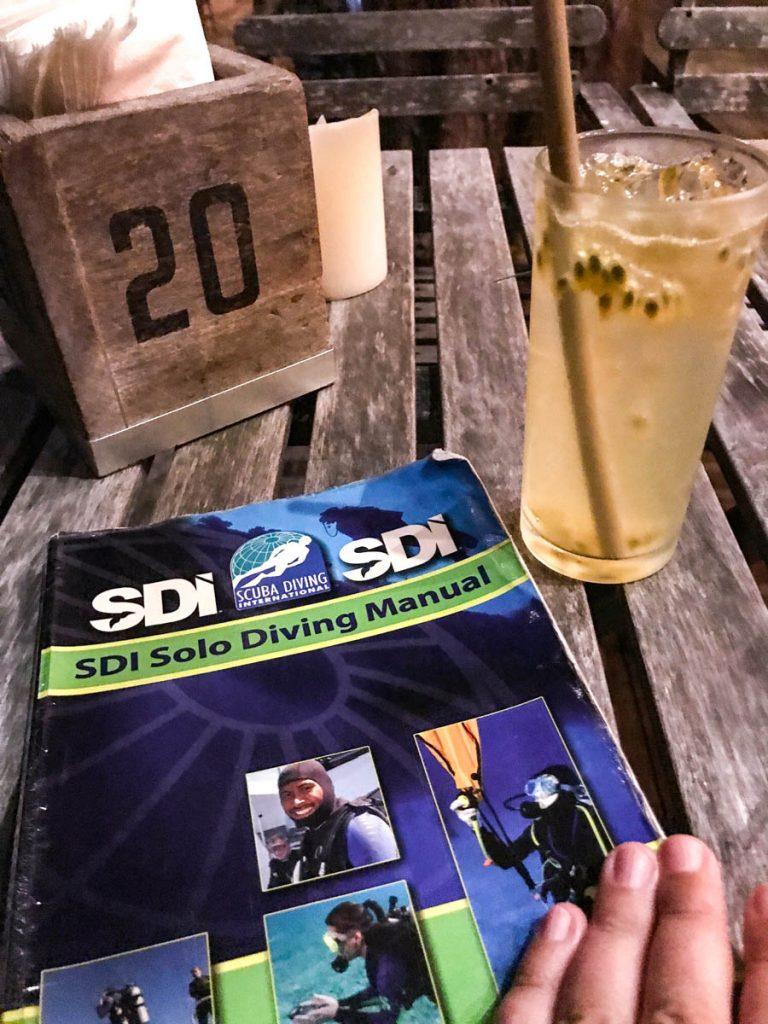 SDI Solo Diver book and drink
