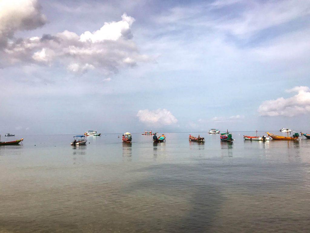 Boats in the ocean on Sairee Beach, Koh Tao