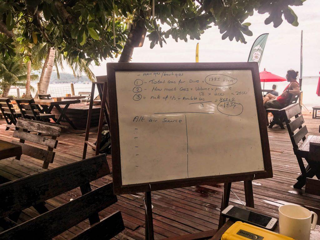 White board with SDI solo diver course lesson