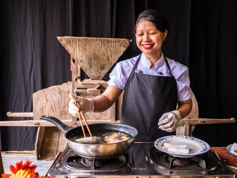 female chef at cooking class hoi an