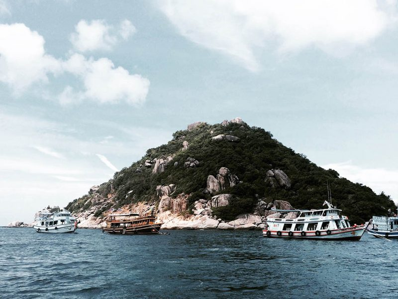 Shark island with dive boats in Koh Tao, Thailand