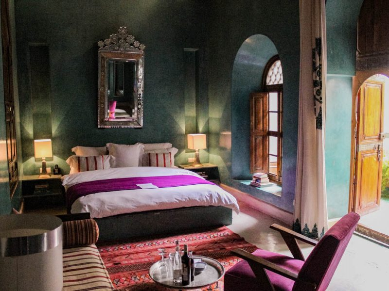Room at El Fenn in Marrakech with big bed and turquoise walls